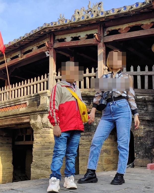 Cô gái mặc đồ xuyên thấu, tạo dáng chụp ảnh phản cảm tại di tích ở Hội An, Đà Nẵng - Ảnh 1.