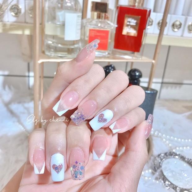 Sau Tết muốn tậu bộ nail đơn giản, xinh yêu thì bạn hãy tia 8 mẫu hot nhất tại các tiệm lúc này - Ảnh 1.