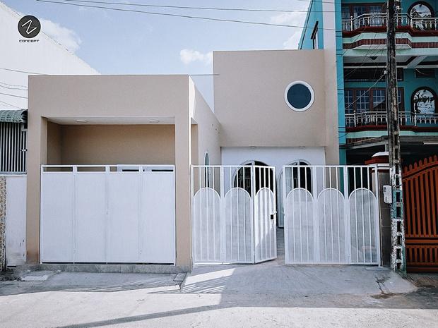 Ngôi nhà không cầu kỳ nhưng vẫn cực mê đắm với những đường cong tinh tế, trắng sáng nổi bật cả góc phố - Ảnh 1.