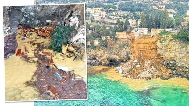Lở đất ở nghĩa trang trên vách núi khiến 200 quan tài rơi xuống biển - Ảnh 1.