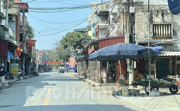 Người bán thịt lợn ở thị trấn Cẩm Giang buộc phải đi cách ly tập trung - Ảnh 1.