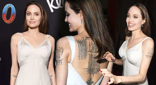 Cậu con trai cả nhà Angelina Jolie gây chú ý với ảnh cởi trần khoe hình xăm dữ dằn - Ảnh 8.