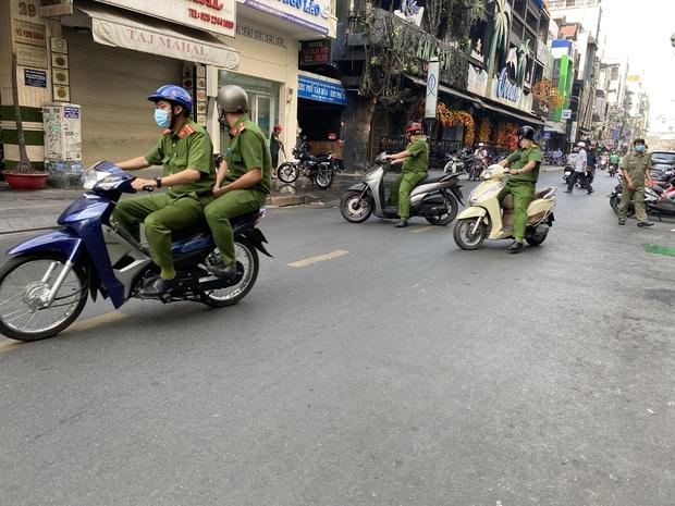 TP. HCM: Phong tỏa quán cafe trên phố đi bộ Bùi Viện vì BN1883 ở Hà Nội từng ghé - Ảnh 1.