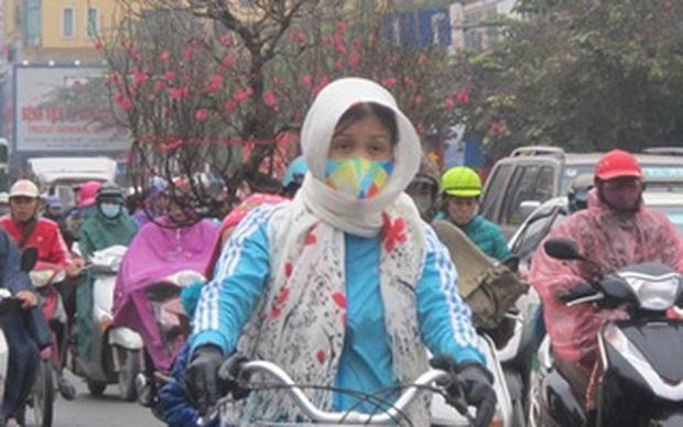 Hà Nội 17 độ C, đừng rửa xe đi Tết vội vì sang tuần có mưa giông - Ảnh 1.