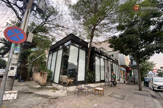 Quán cà phê The Coffee House, quán ăn, lẩu dê ở TP.HCM bị phong toả vì nhân viên sân bay Tân Sơn Nhất mắc Covid-19 từng đến - Ảnh 1.