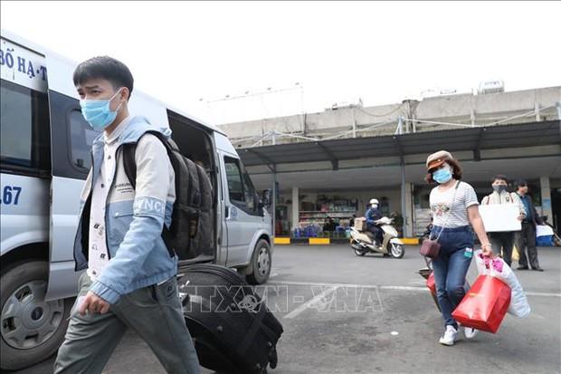 Về quê đón Tết, người dân cần làm gì để tránh lây nhiễm COVID-19?  - Ảnh 1.