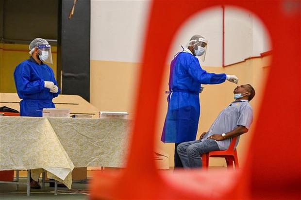 Thế giới có hơn 119,2 triệu ca nhiễm COVID-19, dịch bùng phát mạnh tại Campuchia - Ảnh 1.