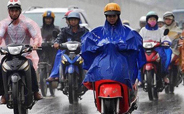 Gió mùa đông bắc tràn về, Hà Nội mưa rét, nền nhiệt giảm nhanh, thấp nhất 15 độ C - Ảnh 1.