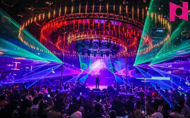Hà Nội cho phép quán bar, karaoke, vũ trường hoạt động trở lại từ 0h ngày 23/3 - Ảnh 1.