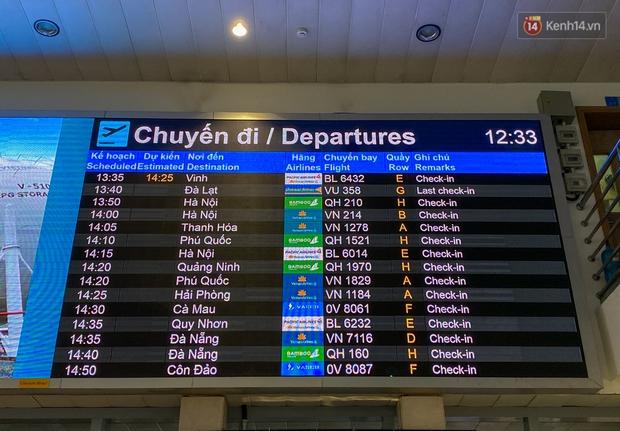 Ảnh: Người dân đổ xô đi du lịch, sân bay Tân Sơn Nhất đông nghẹt khách - Ảnh 6.