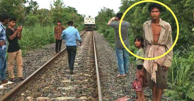 Bố lôi con gái chạy ra chặn tàu lửa đang lao đến khiến người lái tàu bối rối, hành động tưởng như điên rồ nhưng đã cứu sống 2.000 con người - Ảnh 1.