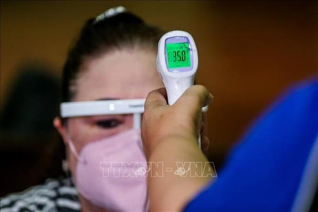 Thế giới có hơn 117,5 triệu ca mắc COVID-19, Mỹ đối mặt với nguy cơ làn sóng lây nhiễm thứ 4 - Ảnh 1.