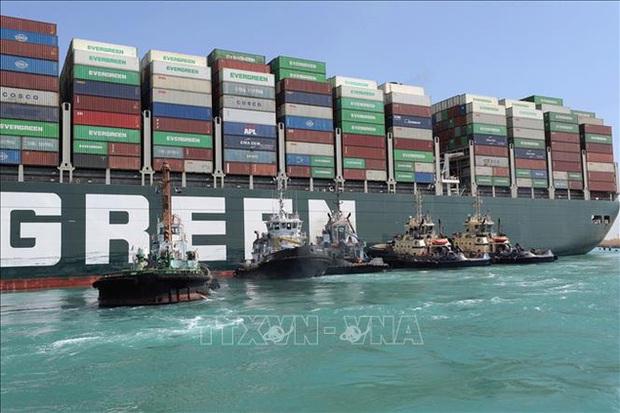 Vụ tàu mắc kẹt ở kênh đào Suez: Giải tỏa hoàn toàn tình trạng ùn tắc - Ảnh 1.