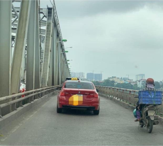 BMW tiền tỉ gắn biển taxi chạy trên phố Hà Nội khiến người đi đường xôn xao, chụp ảnh đăng lên MXH - Ảnh 2.