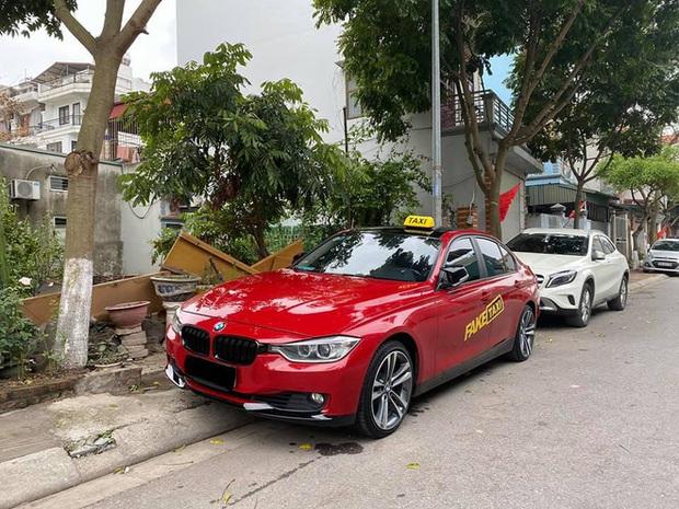 BMW tiền tỉ gắn biển taxi chạy trên phố Hà Nội khiến người đi đường xôn xao, chụp ảnh đăng lên MXH - Ảnh 4.