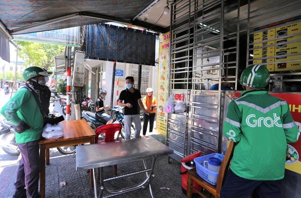 Đà Nẵng tạm dừng hoạt động xe Grab, taxi, xe ôm và shipper để phòng chống dịch Covid-19 - Ảnh 1.