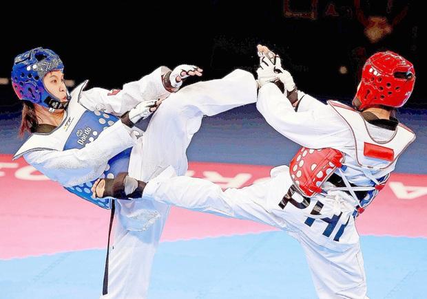 Trương Thị Kim Tuyền đưa Taekwondo Việt Nam trở lại Olympic - Ảnh 1.