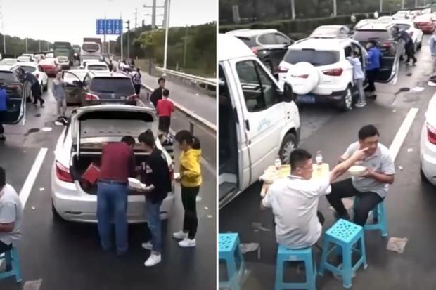 Đoạn clip gây sốt về cảnh kẹt xe tới mức phải ngồi ăn uống chờ thông đường, may mà sự thật khiến ai cũng thở phào - Ảnh 2.