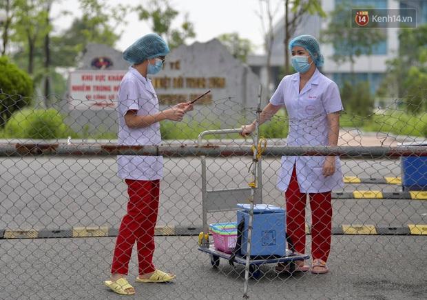Hà Nội thêm 4 ca dương tính với SARS-CoV-2 liên quan Vĩnh Phúc và BV Bệnh nhiệt đới Trung ương - Ảnh 1.