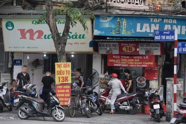 Phố xá Hà Nội tấp nập người đi lại, mua bán, tập thể dục: Mọi người đều đeo khẩu trang phòng dịch Covid-19 - Ảnh 5.