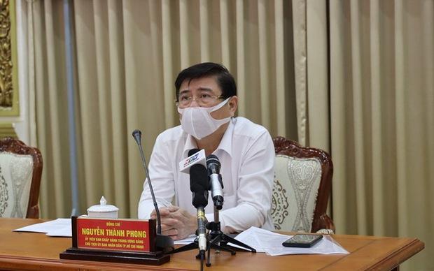 Chủ tịch UBND TP Nguyễn Thành Phong lấy ý kiến quận Gò Vấp, quận 12: Có tiếp tục giãn cách nữa hay không - Ảnh 1.