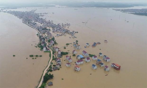 Mực nước của 21 con sông ở Trung Quốc vượt mức cảnh báo lũ - Ảnh 1.