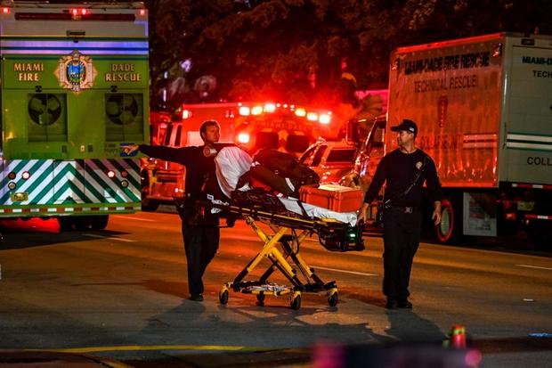 Hiện trường đổ nát vụ sập chung cư kinh hoàng ở Miami (Mỹ) - Ảnh 12.