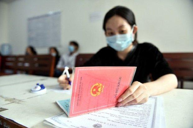 6 chính sách mới có lợi cho người dân từ 1/7: Bỏ điều kiện riêng khi nhập hộ khẩu vào Hà Nội, TP.HCM - Ảnh 1.