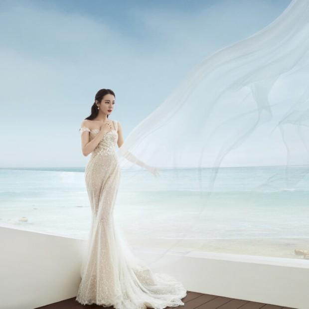 Giữa scandal phá thai và bí mật lấy chồng, bộ ảnh mặc váy cưới khoe đường cong nức nở của Nhiệt Ba bất ngờ hot hòn họt - Ảnh 2.