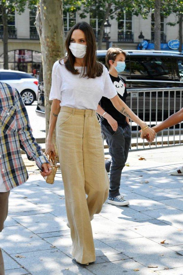 Mẹ con Angelina Jolie đi shopping mà gây xôn xao đường phố Paris, spotlight đổ dồn về cô con gái Shiloh với màn lột xác nữ tính - Ảnh 9.