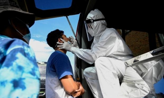 Thảm kịch Covid-19 tại Indonesia: Nhân viên nghĩa trang phải làm việc suốt ngày đêm - Ảnh 1.