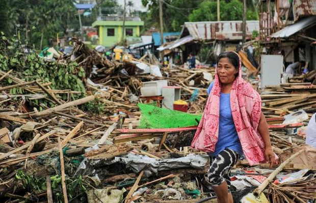 Gió mùa, bão nhiệt đới nhấn chìm thủ đô của Philippines - Ảnh 3.