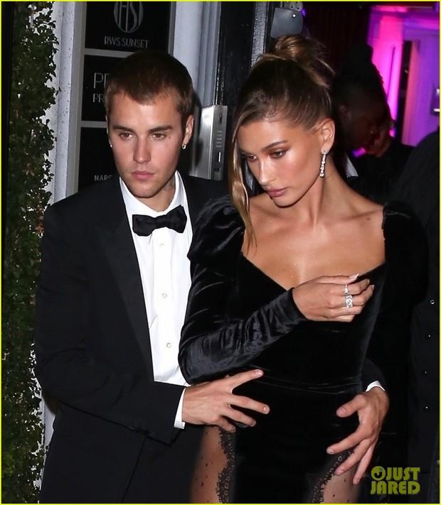 Vợ chồng Justin Bieber tung ảnh sự kiện hot: Chàng thần thái đỉnh cao, spotlight lại dồn về vòng 3 lộ gần hết của Hailey - Ảnh 10.