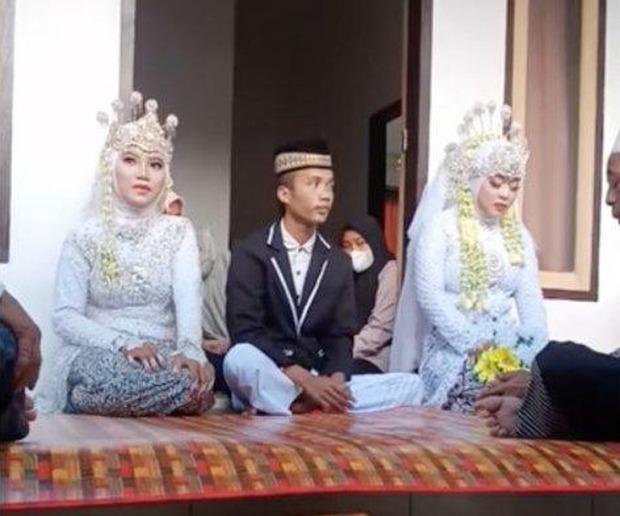 Chú rể kết hôn cùng lúc với 2 cô dâu, tưởng số hưởng nhưng thân phận 2 người phụ nữ đều gây bất ngờ - Ảnh 1.