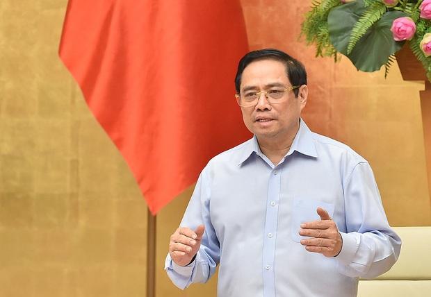 Thủ tướng: Chống dịch COVID-19 còn rất trường kỳ, không để khủng hoảng kinh tế - xã hội - Ảnh 2.