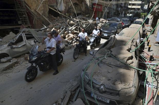 Một năm sau thảm họa ở cảng Beirut, những vết thương để lại vẫn chưa lành - Ảnh 10.