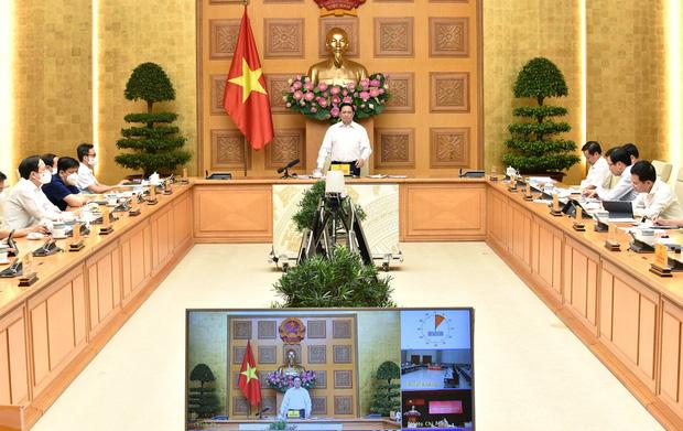 Thủ tướng: Quân đội chủ trì lo lương thực cho người dân TP.HCM - Ảnh 1.