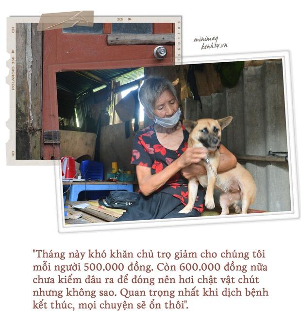 Khu ổ chuột Hà Nội những ngày giãn cách: Người dân sống nhờ gạo cứu trợ nhưng vẫn còn đó những nụ cười lạc quan - Ảnh 7.