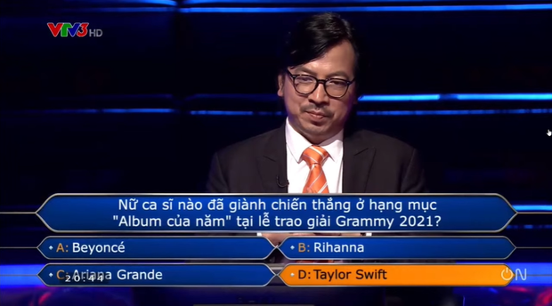 Ai Là Triệu Phú hỏi ai giành giải Album của năm tại Grammy 2021, nam thần đấu kiếm chọn Taylor Swift hay Ariana Grande? - Ảnh 4.