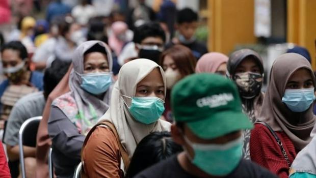 Tâm dịch của Đông Nam Á sẽ sống chung với Covid-19 như thế nào? - Ảnh 1.