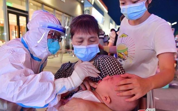 Trung Quốc ghi nhận nhiều ca mắc Covid-19 ở trẻ em, New Zealand kiên trì chiến lược Zero - Ảnh 1.