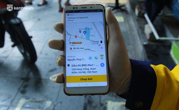 Ảnh: Một quận ở Hà Nội thí điểm đi chợ hộ cho người dân bằng xe công nghệ qua ứng dụng giao hàng - Ảnh 3.