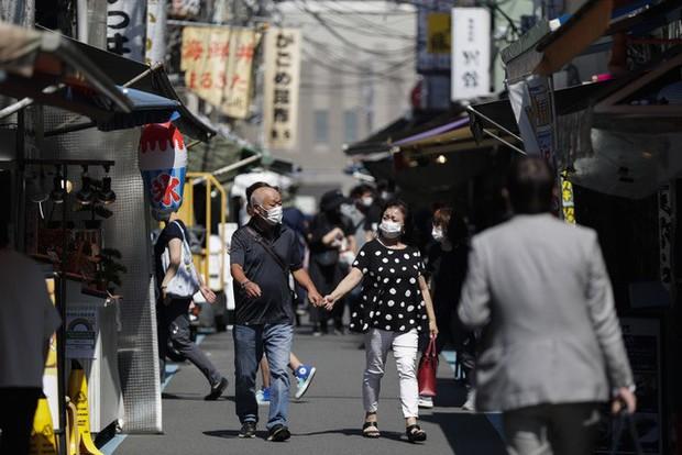 Nhật Bản nới lỏng biện pháp phòng dịch, bình thường hóa các hoạt động kinh tế - xã hội - Ảnh 1.