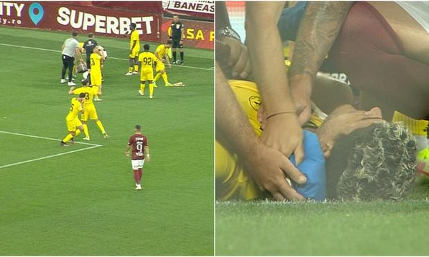 Pháo phát nổ trên sân, cầu thủ né cực dẻo nhưng vẫn đổ gục xuống bất tỉnh - Ảnh 2.
