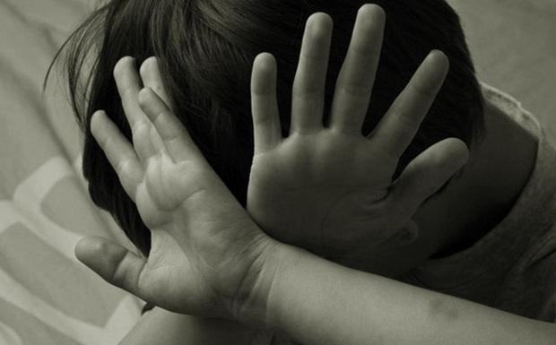 Hà Nội: Gã trung niên xâm hại ba bé gái trong trường tiểu học - Ảnh 1.