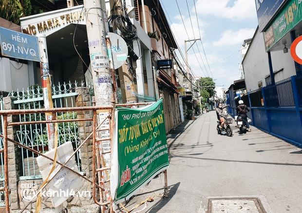 Ảnh: Nhiều rào chắn bít bùng ở TP.HCM dần được dỡ bỏ, người dân di chuyển bình thường - Ảnh 12.