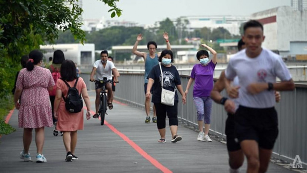 Con đường sống chung với Covid-19 của Singapore và cách thức các nước khác thực hiện - Ảnh 1.