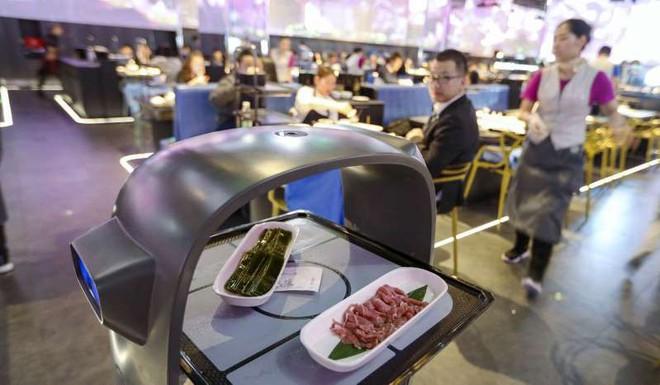 Trung Quốc vừa ra mắt nhà hàng lẩu đầu tiên sử dụng trí tuệ nhân tạo, chỉ cần xem đã thấy bụng sôi ùng ục - Ảnh 3.