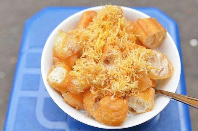 Ở Hà Nội, bạn có thể ăn cháo sườn... cả ngày vì khung giờ nào cũng có hàng bán - Ảnh 1.