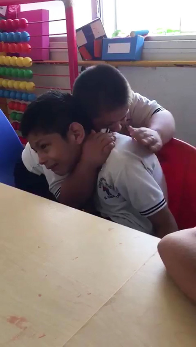 boy-down-syndrome-crying-classmate-autism-video-4-5de9444face61700-1575712495768648659742.jpg